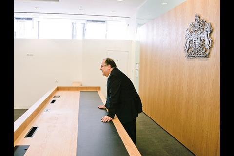 Justice minister Lord Falconer tests a courtroom.